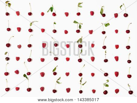Lot Of Raspberries And Cherries Arranged On White