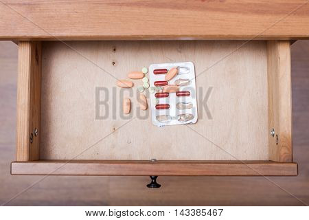 Several Pills In Open Drawer