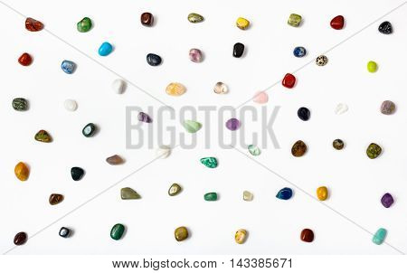 Many Semi-precious Stones Arranged On White