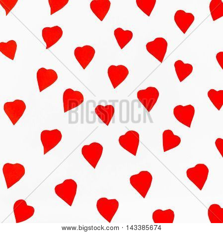 Red Hearts Carved From Paper On White