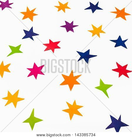 Various Stars Carved From Colored Paper On White