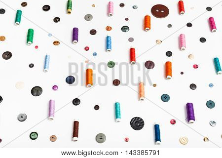 Side View Of Spools Of Thread And Various Buttons