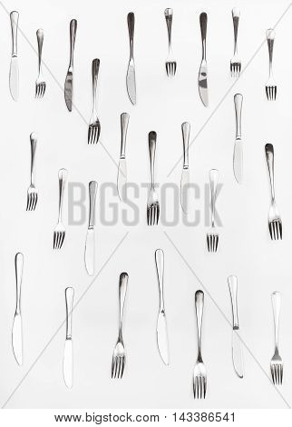 Vertical Set Of Table Knives And Forks On White