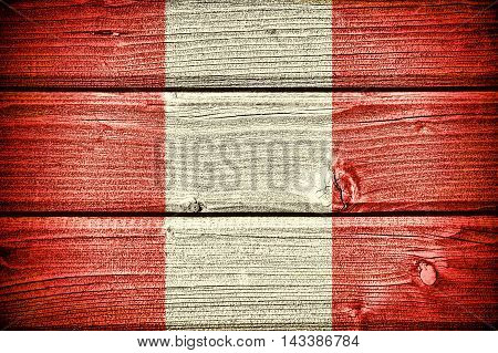 Flag of Peru painted on old grungy wooden background