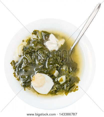 Top View Of Soup In Plate With Spoon From Greens