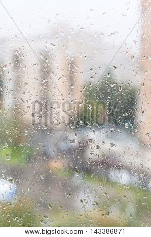 View Of Wet Window Glass Of Apartment House