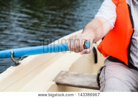 Paddler With Oar On Boat During Water Walk