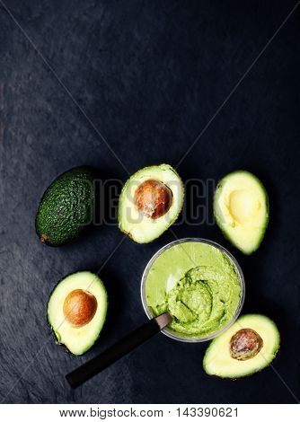 Halved avocados. Guacamole. Avocado cream spread pasta