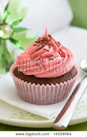 Pink cupcake, ready to eat
