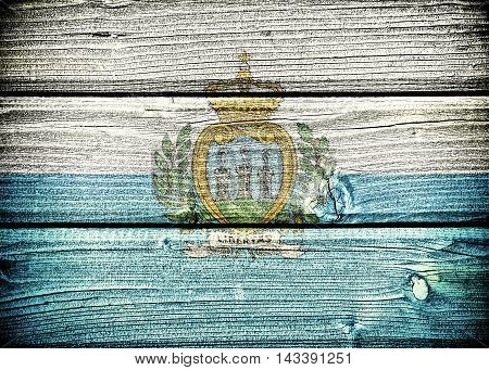 flag of San Marino painted on old grungy wooden background: 3d illustration