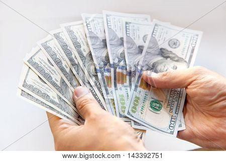 Hand holding money - United States dollar close up