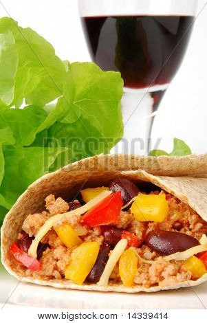 Burrito with meat, beans and a glass of wine