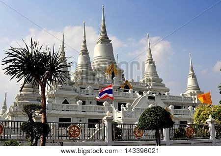 Samut Prakan Thailand - January 15 2013: The gleaming white Wat Asoke with its seven Chedis with ringed spires