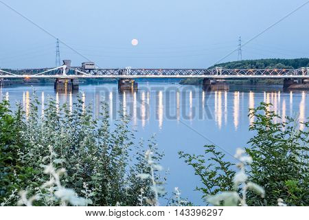 an long bridge on the Scheldt with rising moon