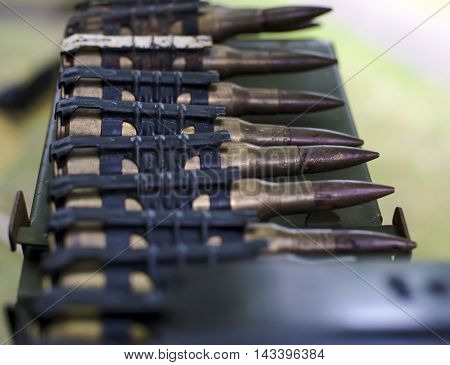 cartridges in cartridge belts with shallow depth of field