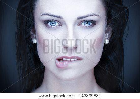 Sexy brunette woman bite lips beauty portrait