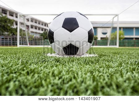 soccer ball on the football field green