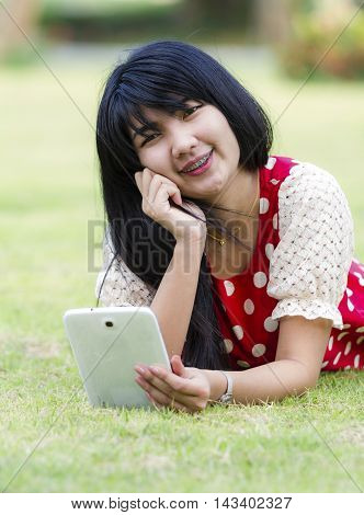 Asian Young woman using her tablet pc