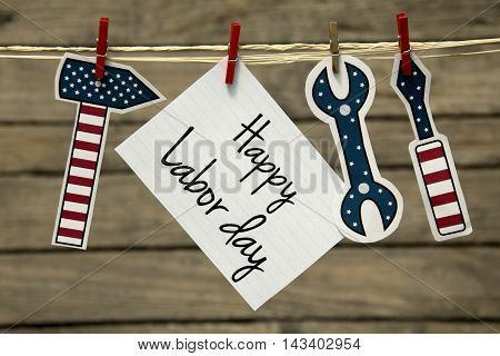 Labor day greeting card or background with hanging tools.