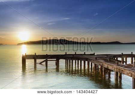 Sunrise by the shore with jetty view