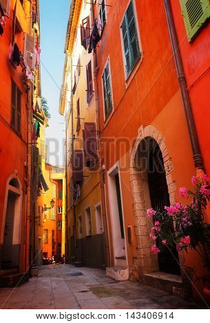 narrow street in old town of Nice, France, toned