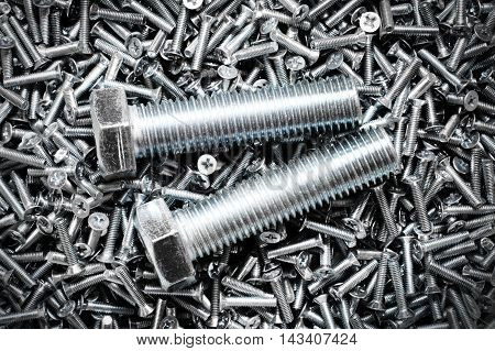 Two fasteners bolts. A lot of bolts and screws
