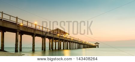 Wood jetty on the Beach and tropical sea.