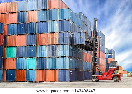 forklift handling container box loading from dock to truck