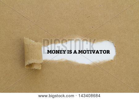 MONEY IS A MOTIVATOR message written under torn paper.