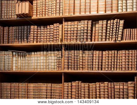 VIENNA, AUSTRIA - MAY 30, 2016: Vintage wooden bookshelf with old books in the Austrian National Library on May 30, 2016 in Vienna. Est in 18th century the largest library in Austria with 7.4 mill items