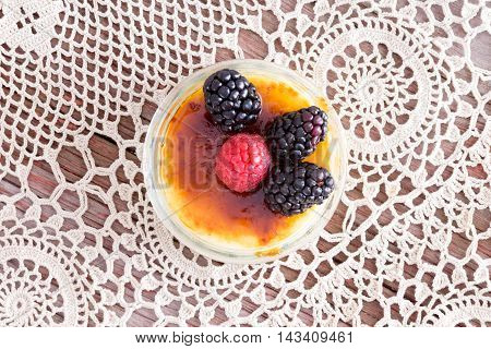 Freshly Prepeared Creme Brulee With Berries