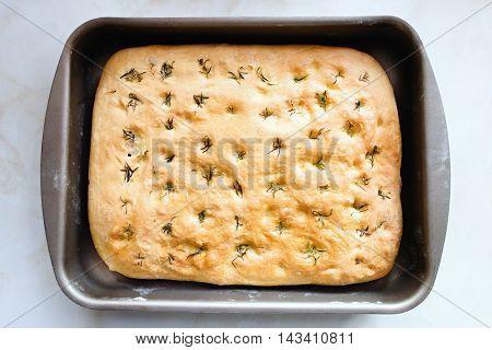 Baked focaccia on a plate. Italian bread.