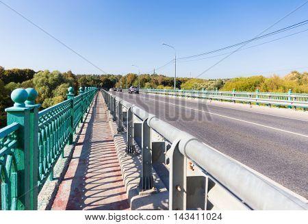 Fenced sidewalk on the bridge without cars