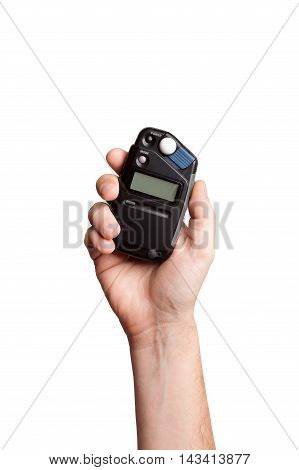 The flash meter in hand on white background