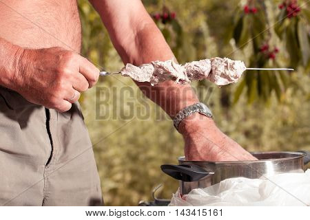 Man Cooking Marinated Shashlik, Meat Grilling On Metal Skewer, C