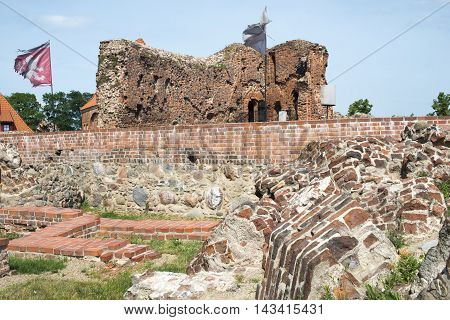 ancient ruined brick walls of crusaders castle in Torun Poland