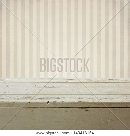 Background with empty wooden table over retro striped wallpaper