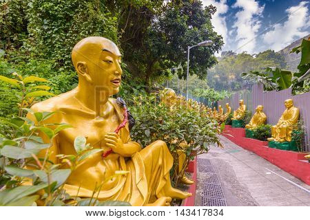 HONG KONG - OCTOBER 14: Statues at Ten Thousand Buddhas Monastery October 14, 2012 in Hong Kong, China. The temple was built by Yuet Kai who spent the last years of his life erecting the temple.