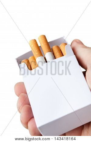 Pack Of Cigarettes In Hand, Isolated On White Background