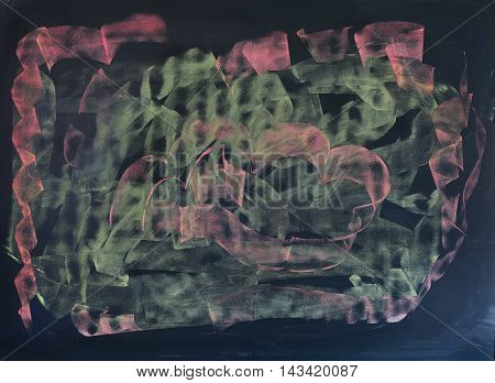 Black chalkboard with random chalk drawing in pink and light green.