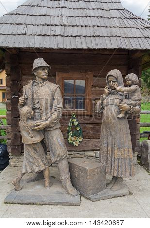 Kolochava Ukraine - April 18 2016: Monument to the villagers - migrant workers who died on earnings in other countries