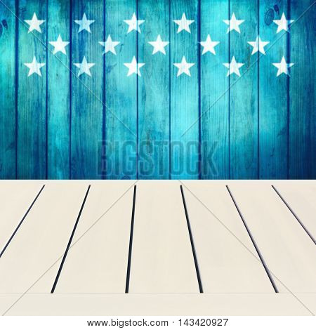 Empty wooden white table over wooden blue background with stars. Independence day 4th of July background. Ready for product display montage.