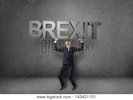 Businessman holding heavy 3d 'brexit' word over his head. British withdrawal. Significant decision. Substantial choice. Europe and United Kingdom. Difficulties and doubts.