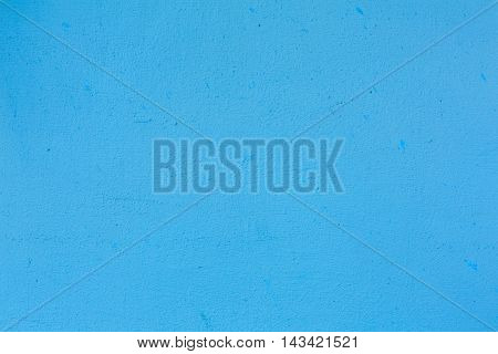 Blue color painted wall texture background for product placement