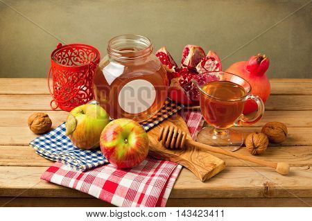 Jewish New Year Holiday celebration with apples and honey