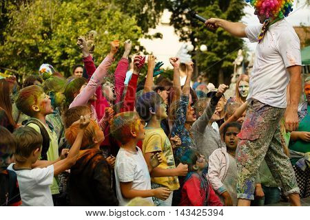 13 August 2016. Kozelsk Russia. Day of the city. Children and animator at the Holi festival.