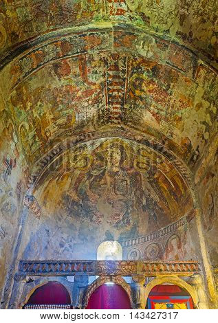 USHGULI GEORGIA - MAY 22 2016: The old crumbling frescoes on the ceiling of Lamaria Church on May 22 in Ushguli.