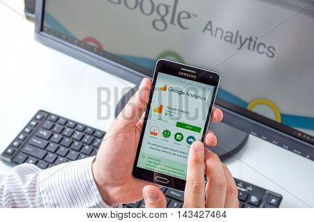 WROCLAW POLAND- AUGUST 18th 2016 : Businessman prepares to install Google Analytics application on Samsung A5. Google Analytics is the one of most widely used application that tracks and reports website traffic.