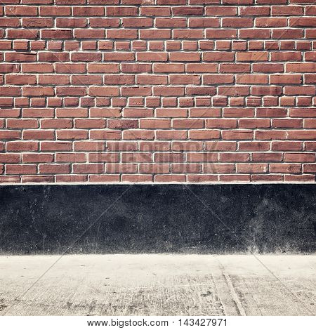 Urban background with brick wall and pavement