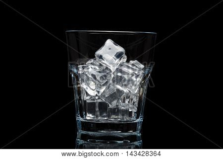 Glassful For Whiskey With Ice Cubes Isolated On Black Background